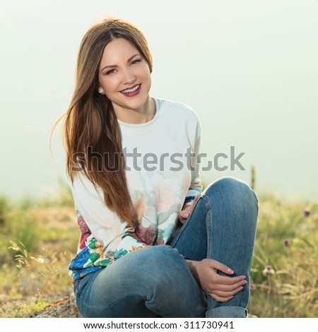 Smiling girl enjoys fine warm spring weather highly in mountains against the sea. . Smiling girl enjoys fine warm spring weather highly in mountains against the sea. Photo with instagram style filters - stock photo