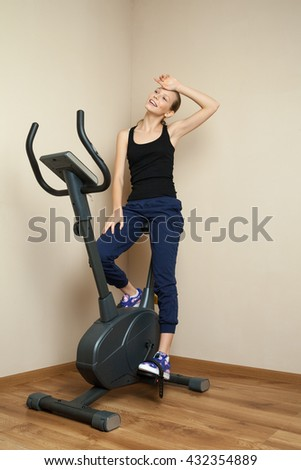 Smiling girl finished cycling  - stock photo