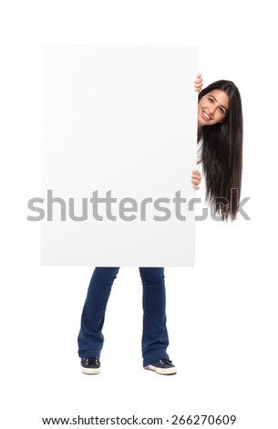 Smiling girl holding a blank board  - stock photo