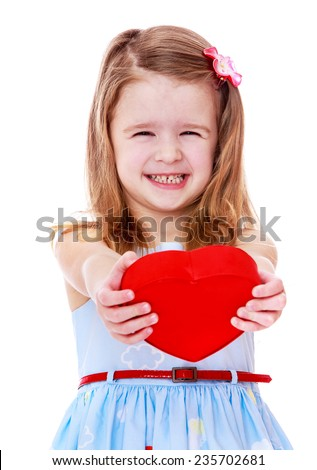 Smiling girl holding a heart.White background, isolated photo.