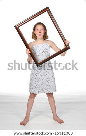 smiling girl holding a picture frame around her head and face and torso