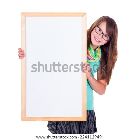 Smiling girl holding an empty white advertising board - stock photo