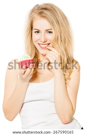 Smiling Girl holding Cake in her hands. Woman with Beautiful Toothy Smile - stock photo
