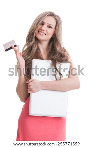 Smiling girl holding closed laptop and a credit card on white background - stock photo