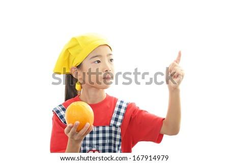 Smiling girl holding fruit - stock photo