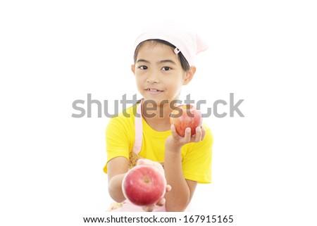 Smiling girl holding fruit? - stock photo