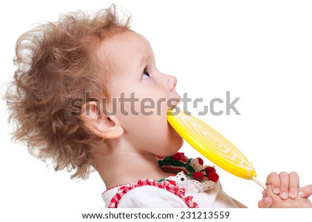 Smiling girl holding her sugar candy - stock photo