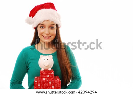 Smiling girl holding piggy bank and presents - stock photo