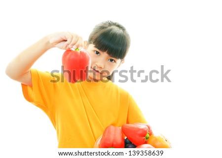 Smiling girl holding vegetables - stock photo