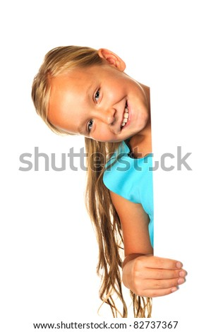 Smiling girl holding white  sheet of a paper, isolated - stock photo