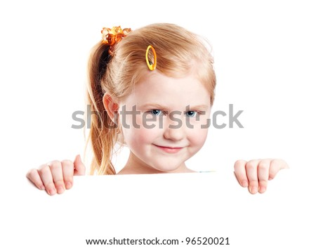 Smiling girl holding white sheet of a paper, isolated on white