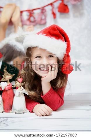 Smiling girl in a Santa hat - stock photo
