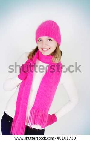 smiling girl in bright hat and scarf