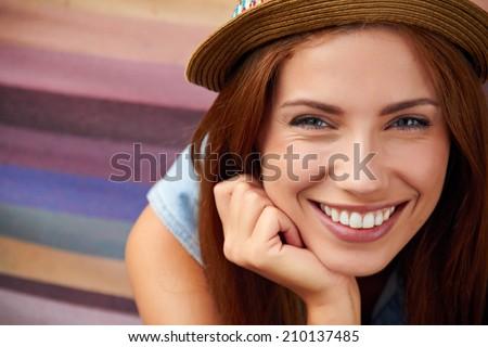 Smiling girl in hat - stock photo