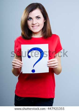 smiling girl in red shirt holding a question mark