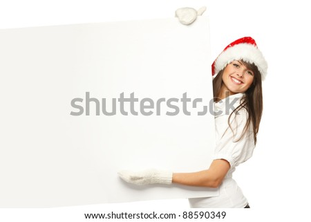 Smiling girl in Santa hat holding blank banner, isolated on white background - stock photo