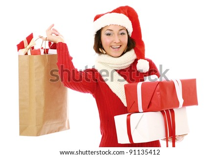 Smiling girl in santa hat with bag full of xmas gift isolated on white background