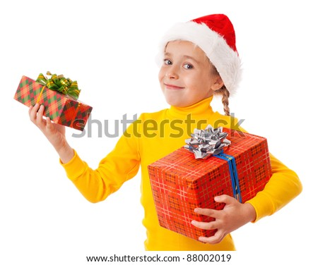 Smiling girl in Santa hat with two gift boxes, isolated on white