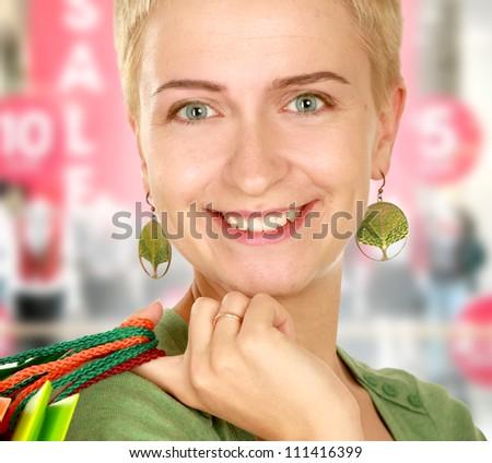 Smiling girl in shop - stock photo