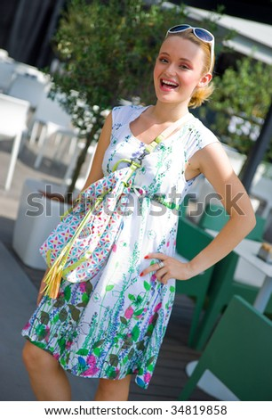 smiling girl in summer dress with bag - stock photo