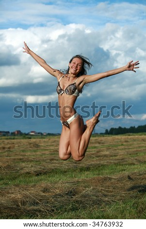 Smiling girl in the lingerie - stock photo