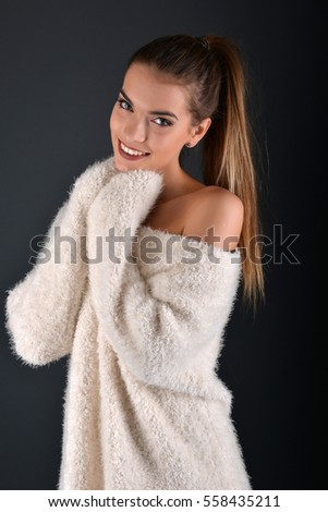 Smiling girl in the white sweater