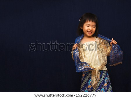 Smiling Girl in Traditional Thai dress - stock photo