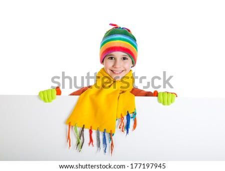 Smiling girl in winter clothing standing with empty horizontal banner in hands, isolated on white