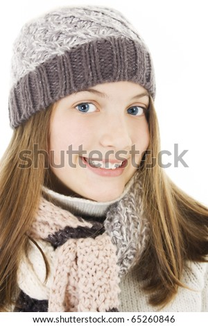 Smiling girl in winter style. Isolated on white.