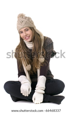 Smiling girl in winter style on a white background - stock photo