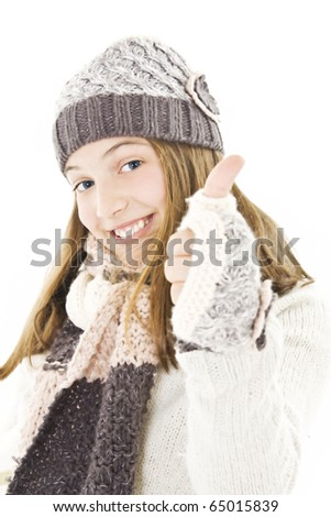 Smiling girl in winter style, showing OK sign.