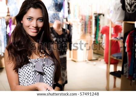 Smiling girl is shopping - stock photo