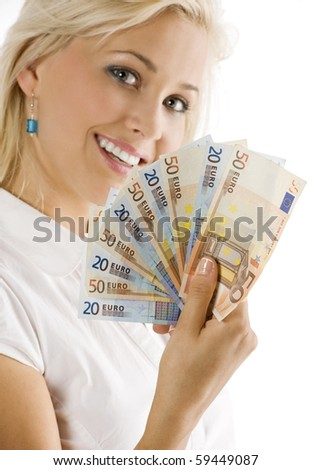 smiling girl keeping a fan of euro cash . FOCUS ON THE MONEY . FACE NOT IN FOCUS - stock photo