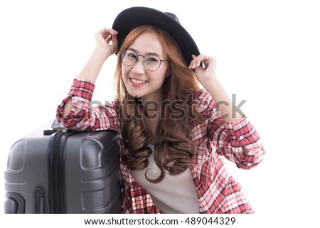 Smiling girl leaning on her suitcase