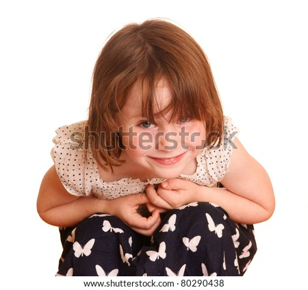 Smiling girl looking in the camera, isolated against background - stock photo