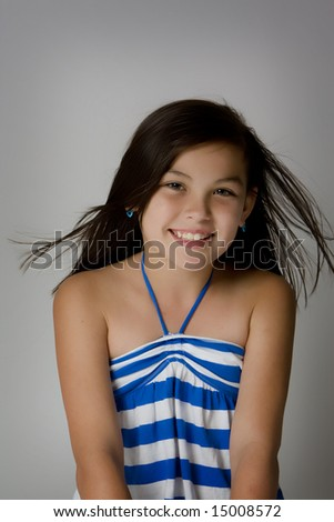Smiling girl looking into camera - stock photo