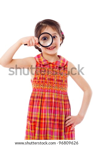 Smiling girl looking through a magnifying glass, isolated on white - stock photo