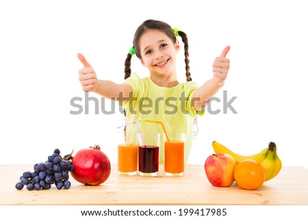 Smiling girl on the table with fruits and juice showing thumbs up sign, isolated on white - stock photo