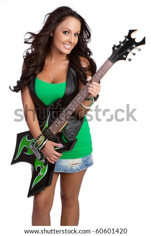 Smiling girl playing electric guitar - stock photo