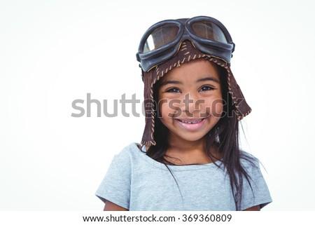 Smiling girl pretending to be pilot on white screen - stock photo