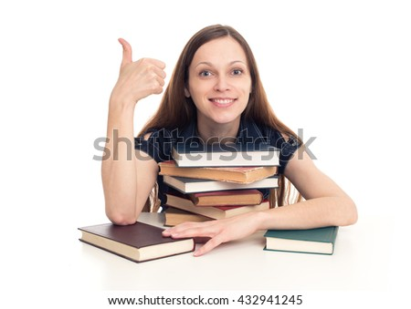 smiling girl sitting at desk with books over white background