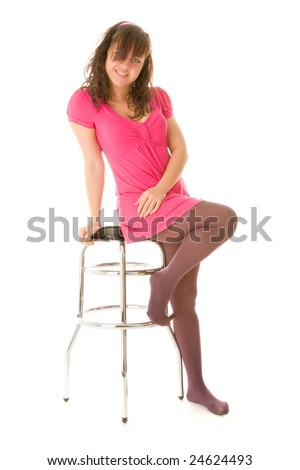 Smiling girl sitting on a bar chair