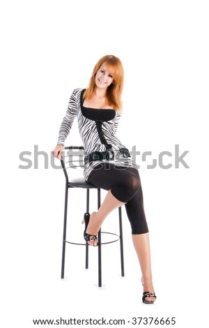 Smiling girl sitting on bar chair