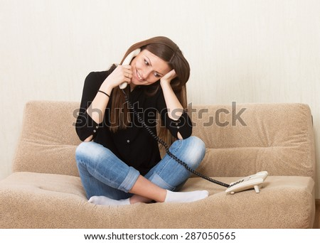 Smiling girl talking on the telephone
