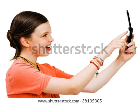 Smiling girl text messaging on a mobile phone isolated over white - stock photo
