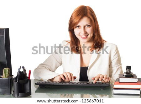 smiling girl typing on a computer keyboard in the office on a white background isolated