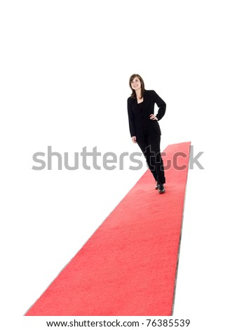 Smiling girl walking on red carpet isolated on white - stock photo