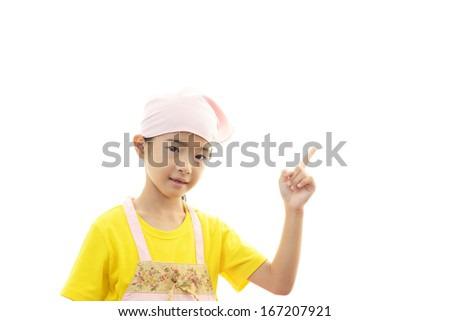 Smiling Girl Wearing Apron - stock photo