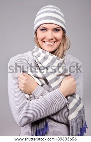 smiling girl wearing winter clothing: sweater, hat ... - stock photo