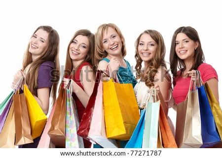Smiling girl with a bag on a white background - stock photo